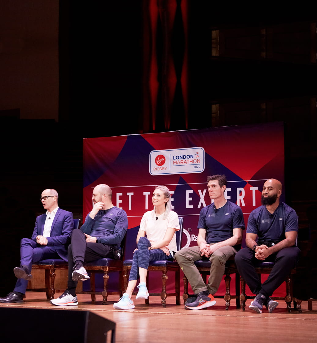 Speakers on stage at Meet the Experts