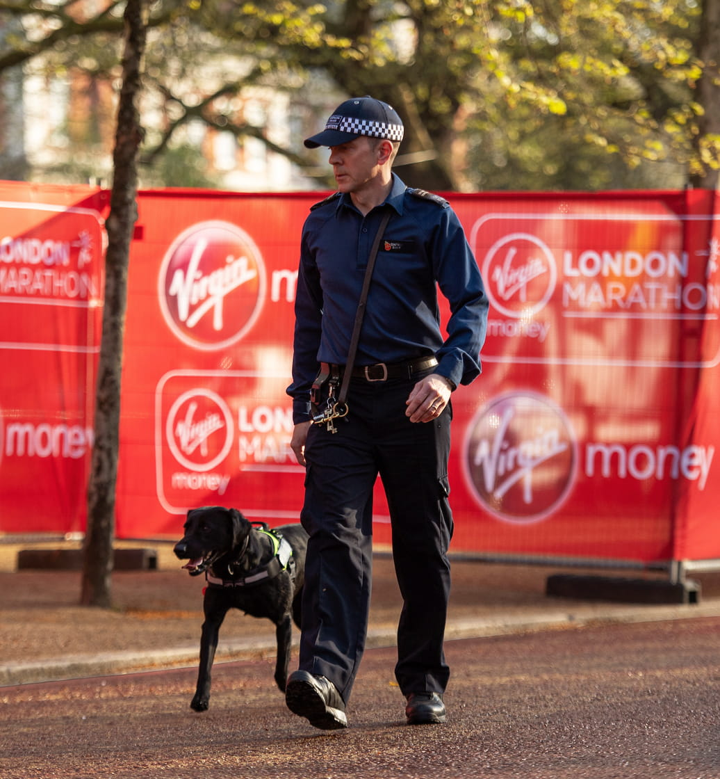 Policeman walks the route with his sniffer dog