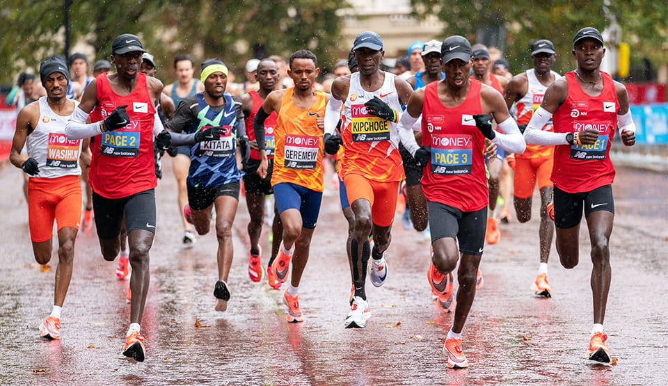 Mosinet Geremew (ETH) and Eliud Kipchoge (KEN) are tucked in behind the pace runners
