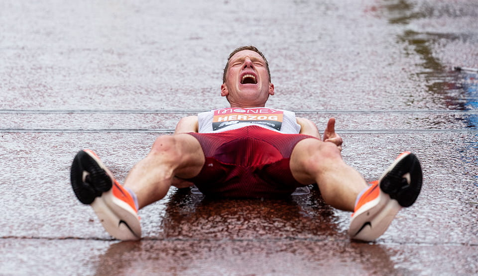 Peter Herzog (AUT) lies on The Mall after finishing the Elite Men's Race