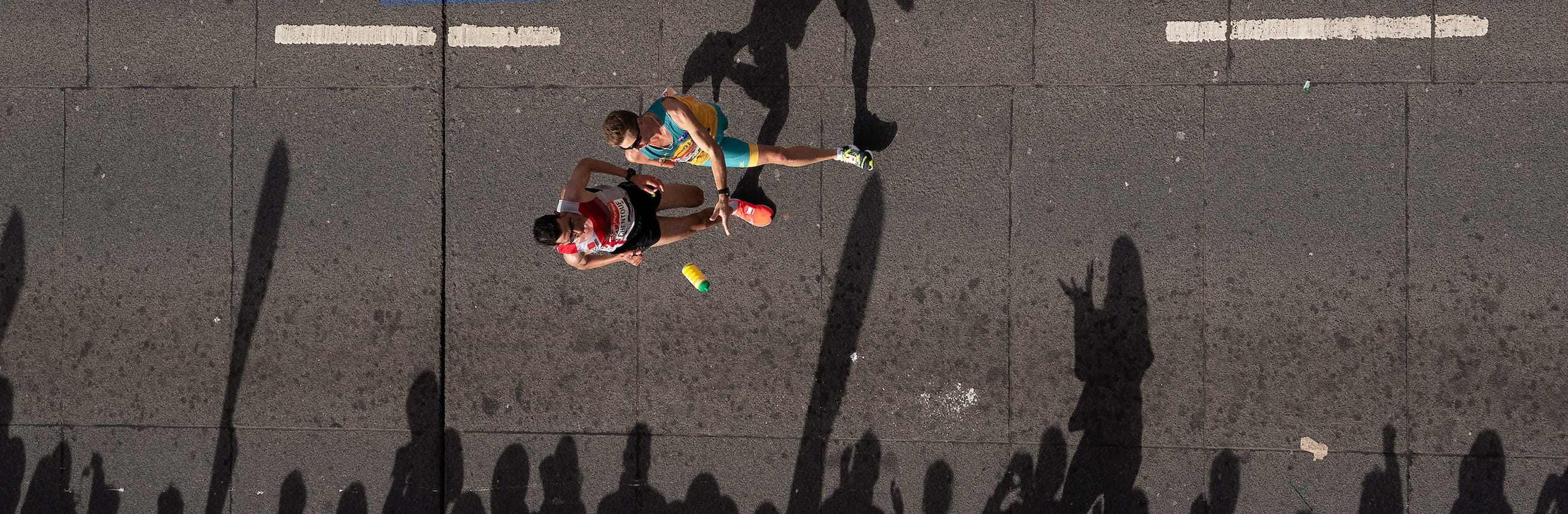 Michael Roeger AUS throws a drinks bottle to a volunteer during the T46 Men World Para Athletics Marathon Championships