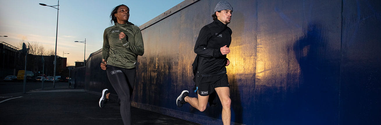 Two runners train in their New Balance kit