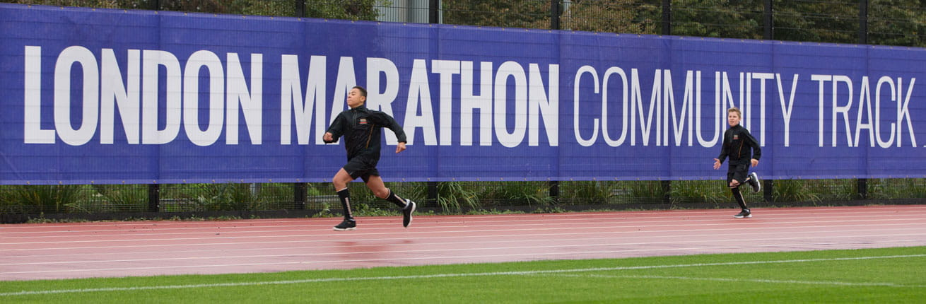 Two runners on the London Marathon Community Track, funded by The London Marathon Charitable Trust
