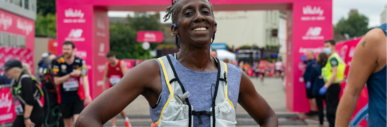 A 2021 Vitality Big Half runner is all smiles after completing the race