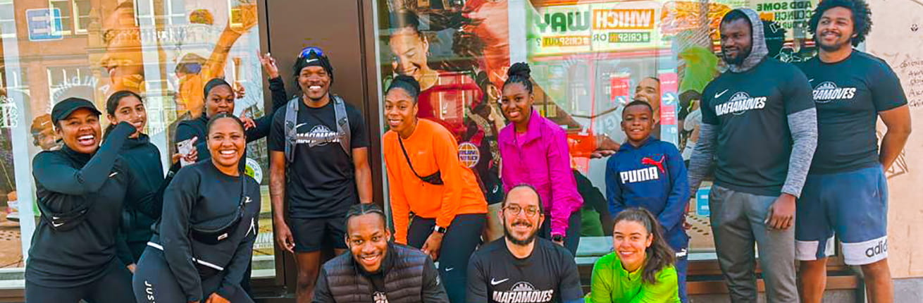 Mafia Moves running crew pictured with Andre Coggins
