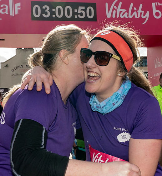 Runners embrace at the Finish Line of The Vitality Big Half