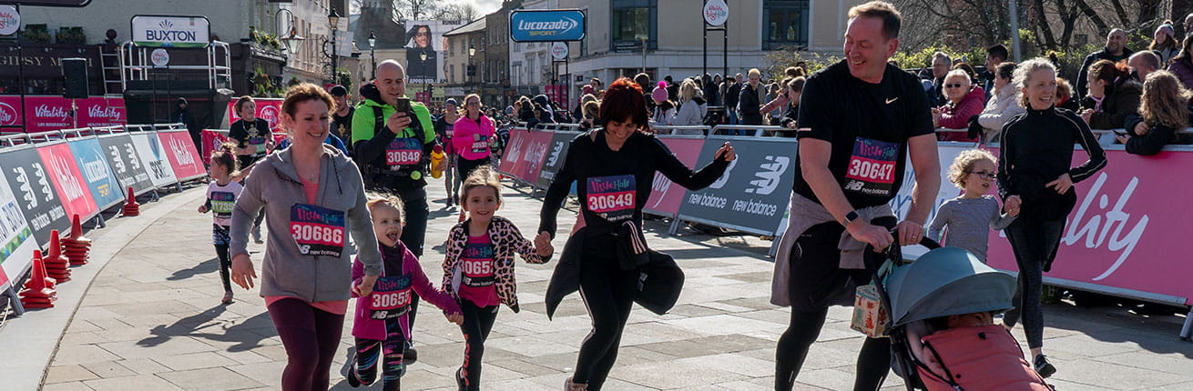 A family running at The Little Half